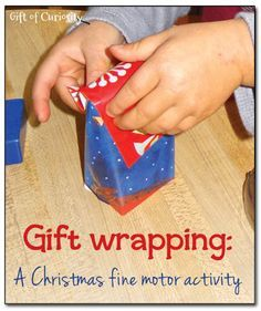 Gift wrapping station for kids - A Christmas fine motor activity. Kids love pretending to wrap gifts and put them under the tree! || Gift of Curiosity