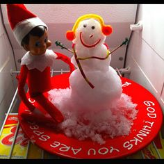 Funny Elf on the Shelf Ideas: If you're lucky enough to live where it snows, make a real [mini] snowman like this in your refrigerator or freezer - too cute. Snowman & Elf are BFFs.