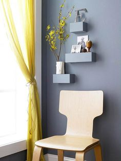 Gray shelves above wood chair out of scraps of 4x4
