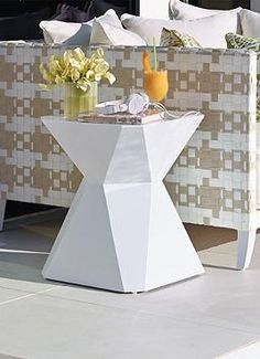 With an intruiging, unique design and glossy finish that can withstand the elements, the Prism Side Table is the perfect piece to make a statement in your outdoor space.