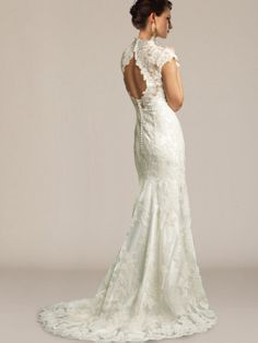 Charming vintage wedding dress! A sophisticated design with beautiful details. Lace overlay with exquisite motifs creates an elegant and romantic look. The sculpted neckline is accented with crystals, while the keyhole back makes this gown mesmerizing. #weddingdresses #lace