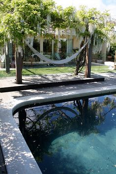 pool surround - poured concrete. raised deck with wisteria arbour and hammock - bliss!