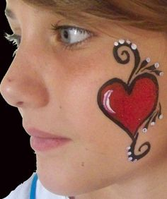 FACE PAINTING.... Heart flourish cheek arm