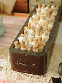 Faith, Grace, and Crafts: laces wrapped around clothes pegs and stored in an old drawer