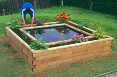 boxed pond - i like the raised flower bed bordering the pond