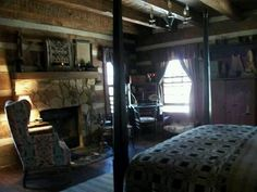 .primitive bedroom log house stone fireplace coverlet 4 poster