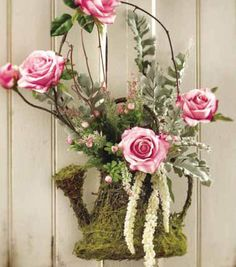 Create a floral arrangement! Find moss, flowers and more from Joann.com or Jo-Ann Stores!