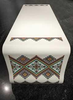 Tables and benches made of DuPont Corian and (literally) embroidered with traditional Ukrainian designs.