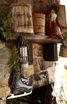 Prim Fireplace Mantel...with old wooden buckets, Santa, & ice skates stuffed with pine.