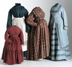 Printed cotton calico pioneer dresses, American, 19th C. L to R: Child's red calico dress, 1860s. Blue calico dress, c. 1895 (with linen apron, c. 1875). Brown printed maternity dress, c. 1860. Light blue printed calico dress (bodice and skirt), 1880.