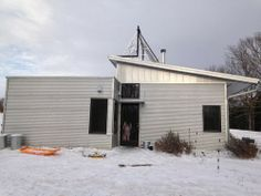 Passive Solar Prefab House Uses Energy Efficiency To Combat A Blizzard And Then... Finds Spring.