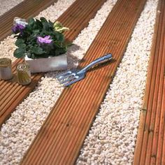 alternative to pavers and gravel - decking and gravel