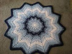 Free Crochet Rose Reds 12 Point Round Ripple Pattern.