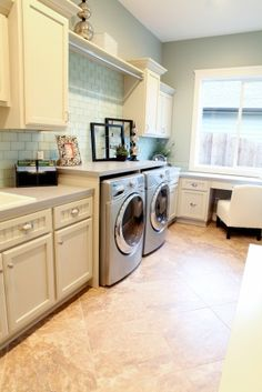 love this laundry room and the little desk by the window...i could sew some pretty great projects there!
