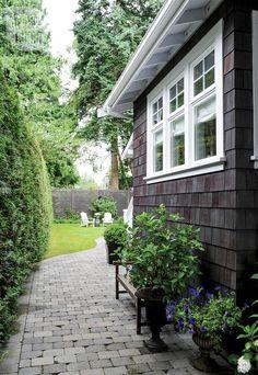 Outdoor decor: Stone pathway to the garage {PHOTO: Tracey Ayton}