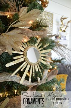 Sunburst Mirror Tree at Tatertots and Jello. Make ornaments out of popsicle sticks! #DIY #Christmas