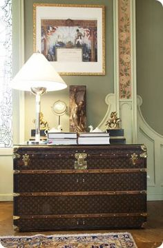 okay... I would need to sell my house to afford this trunk, but....... well, it's just a thought....  vintage louis vuitton steamer trunk as a console table. stunning.