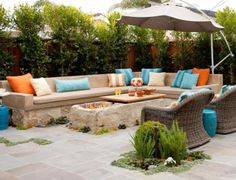 Great entertaining space with a fire pit.  Loving the spaces left open for planting.