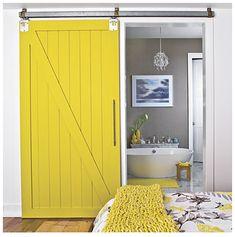 grey walls with a yellow barn door!
