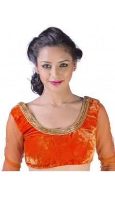 A flame orange velvet saree blouse patterns with sheer net full sleeve, embellished with cut pipe and bead border. Concealed in-built cups Deep round cut back with bead & cut pipe border Full sleeved with sheer net Back hook and eye closure. Recommended for all body types. For more detail visit  http://www.kbshonline.com/