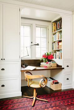 Office on one side of a room.  Making the most of the space you have. Beautiful cabinets and well organized, this set-up could even be done in a bedroom (such as a guest bedroom) and look pretty.