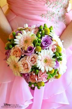 Pink #wedding gown accented by a gerber daisy bridal bouquet #Disneywedding