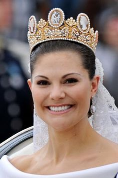 Sweden's Princess Victoria wearing the Cameo Tiara. Once owned by Napoleon's Empress Josephine, The Cameo Tiara came to the Swedish royal family when Josephine's granddaughter Josefina married the future King Oscar I in 1823. The pearl-covered diadem, heightened by seven cameos depicting mythological figures, has become traditional bridal headgear in the House of Bernadotte, with Victoria's mother, Queen Silvia, wearing it on her own wedding day on June 19, 1976.