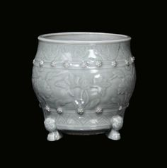 Celadon porcelain censer with floral carved design (diam: 17cm).
