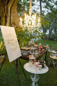 Love the idea of a chandelier hanging from a tree outside.  A touch of magic for an outdoor evening party.