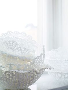Could easily make doily bowls with balloons & spray glue.
