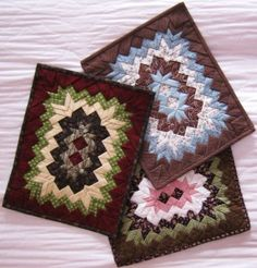 Folded Stars Placemat from http://www.djrichardsdesign.ca/ Somerset Patchwork Prairie Point Qiult