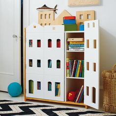 Brownstone city scape bookcase - this bookshelf could double as a dollhouse for kids!