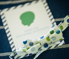 Silhouette Little Man first birthday party: silhouette invitation with striped border + fabric bowties for guests