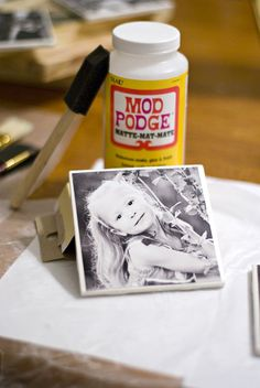homemade picture coasters.  Mod Podge photos to 4x4 white tiles from Lowes, seal with clear acrylic spray sealer and add felt to the bottom.
