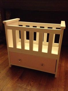 Love this version the best!  Love the flat sides and the drawer for storage underneath.      Rosie's Baby Doll Bed | Do It Yourself Home Projects from Ana White