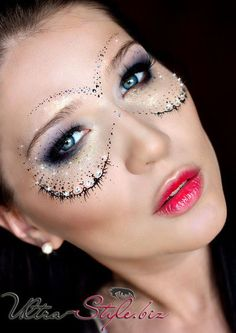 A subtle crystal accented masquerade make-up mask compliments pretty purple smokey eyes.
