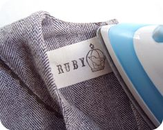 DIY : Hand-stamped Clothing Labels.. can be sewn to the fabric or stuck with iron-on double-sided fusible web.. your pick.