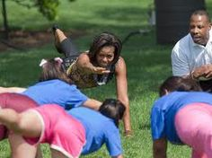 Michelle Obama exercising with students.