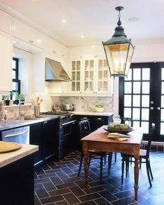 A kitchen that makes me want to linger! Love the black doors and grand scale lighting. This post breaks down what makes this space so amazing… and how to copy it!! via interior designer @FieldstoneHill Design, Darlene Weir #ditto #kitchen #lantern