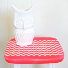 Makeover a thrifted stool with some neon color blocking and a stencil!