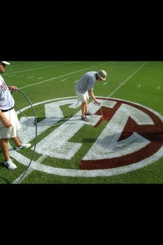Painting the SEC logo on Kyle Field!