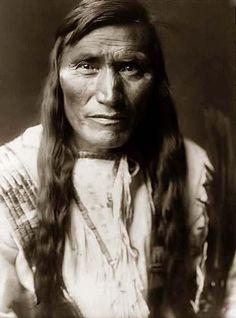 an Atsina man. 1908 by Edward S. Curtis.