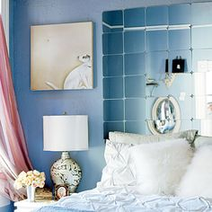 Four-packs of miniature Sorli mirror tiles from Ikea create a glamorous high-end look in place of a pricey tufted headboard.