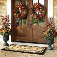 I love these urn arrangements by the front door.