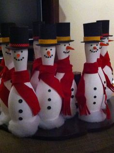 Snowmen crafted from recycled bowling pens