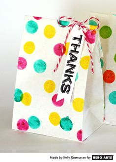 Ink dauber dots on simple white bags = fun party favors.