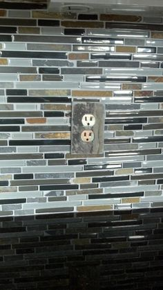 Slate switch plate cover with decals to cover sockets