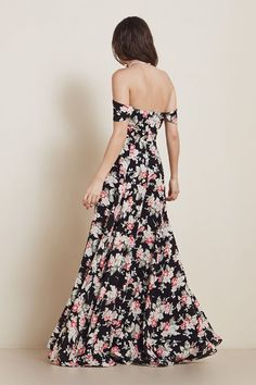 We love, love the off-the-shoulder sleeves + dark floral print of the Constance dress from Reformation