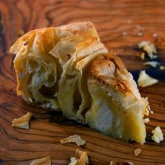 Banitsa =traditional Bulgarian food prepared by layering a mixture of whisked eggs and pieces of cheese between filo pastry and then baking it in an oven.