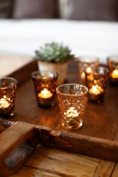 candle light and wooden trays
